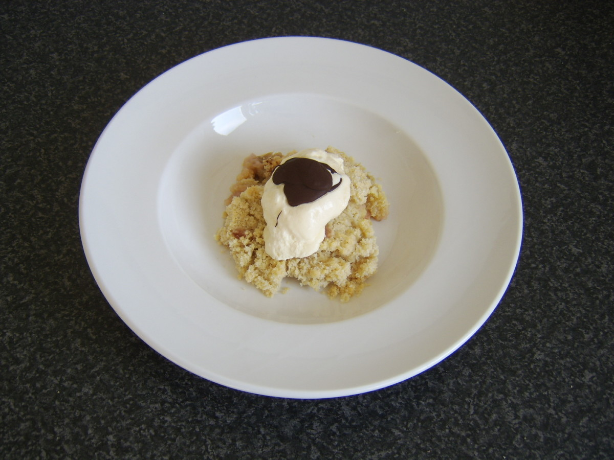 Homemade rhubarb crumble and ginger ice cream is ready to serve