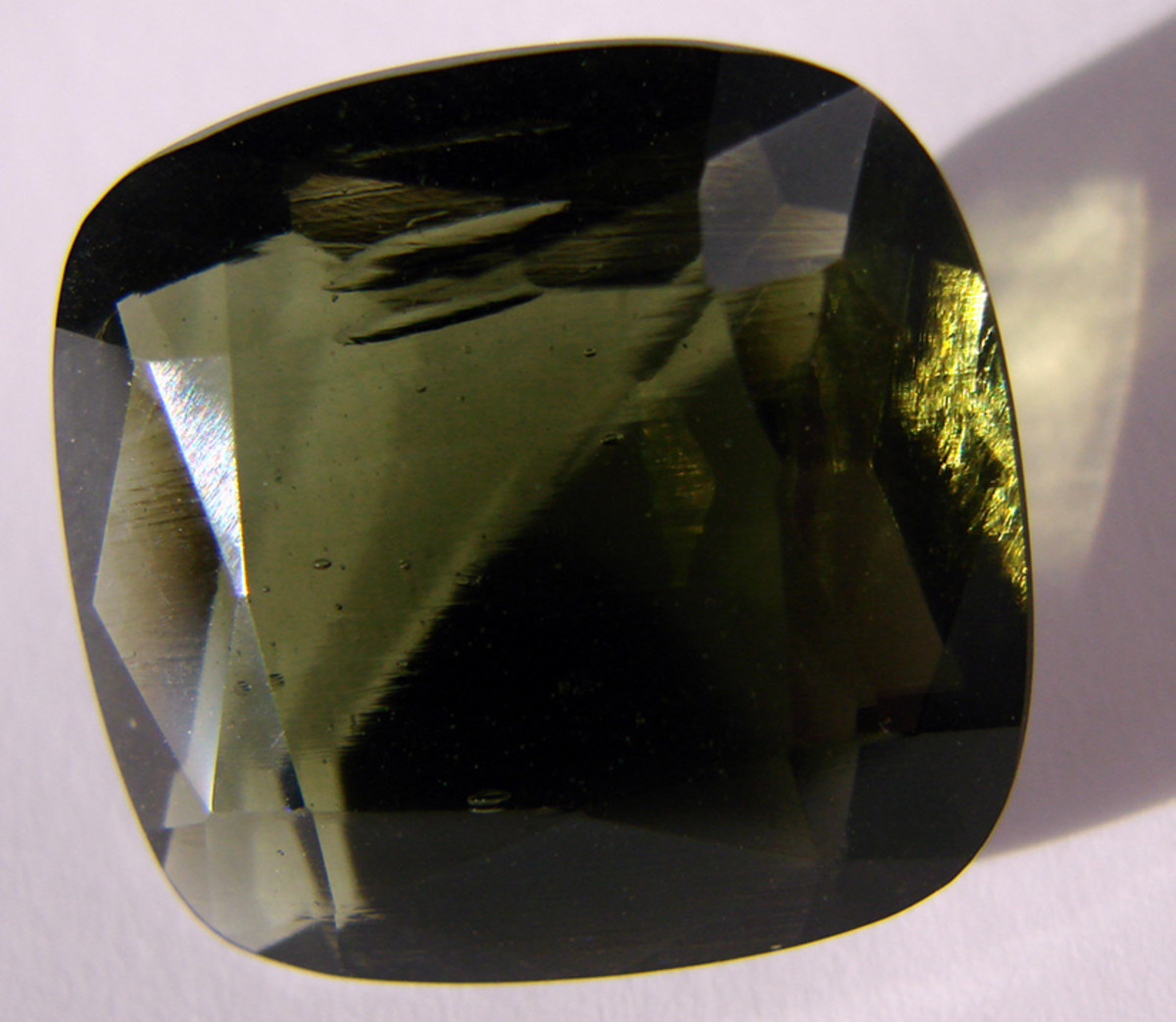 A beautifully cut moldavite specimen.