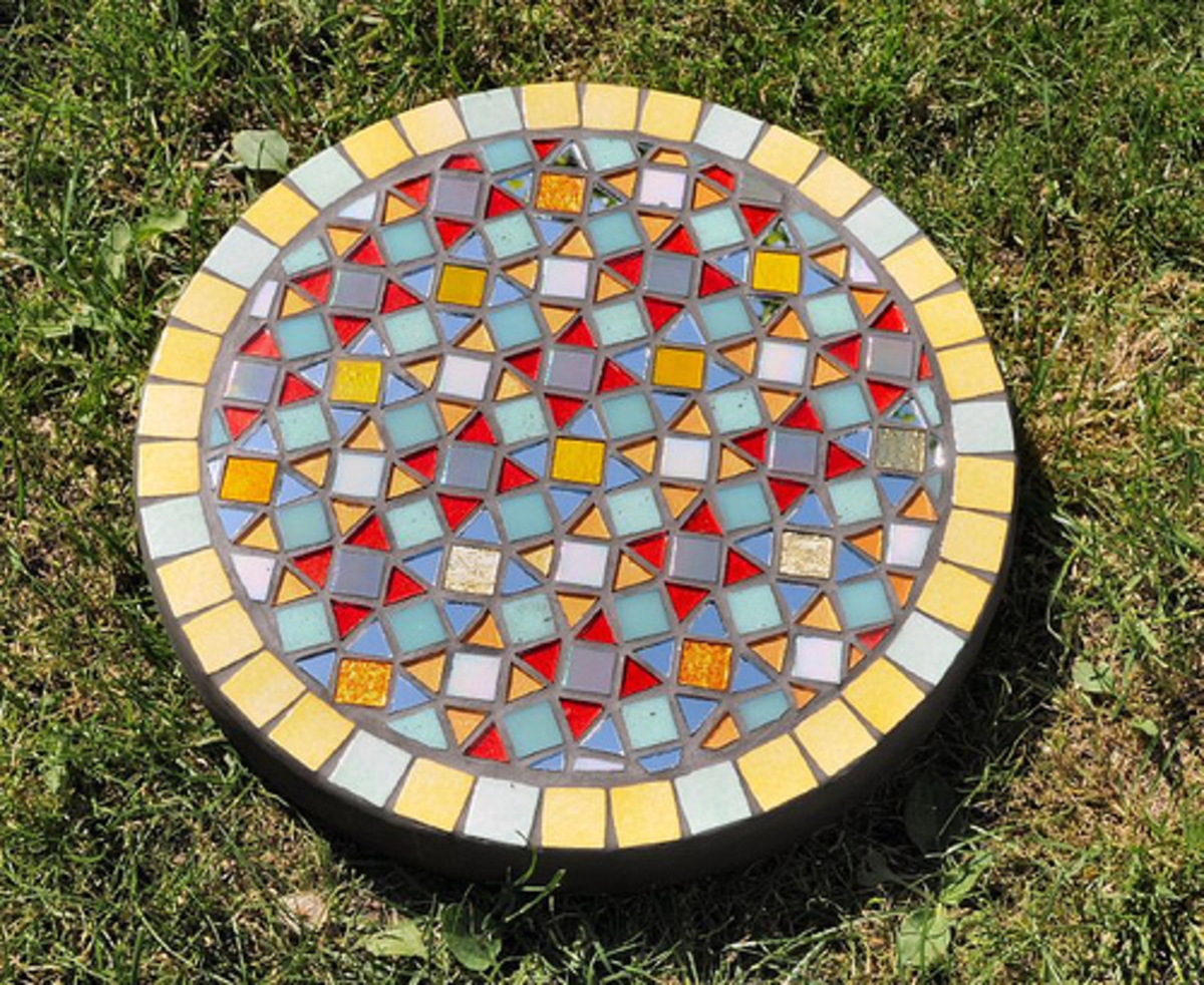Concrete base with hand-painted glass and mirror mosaic pieces.