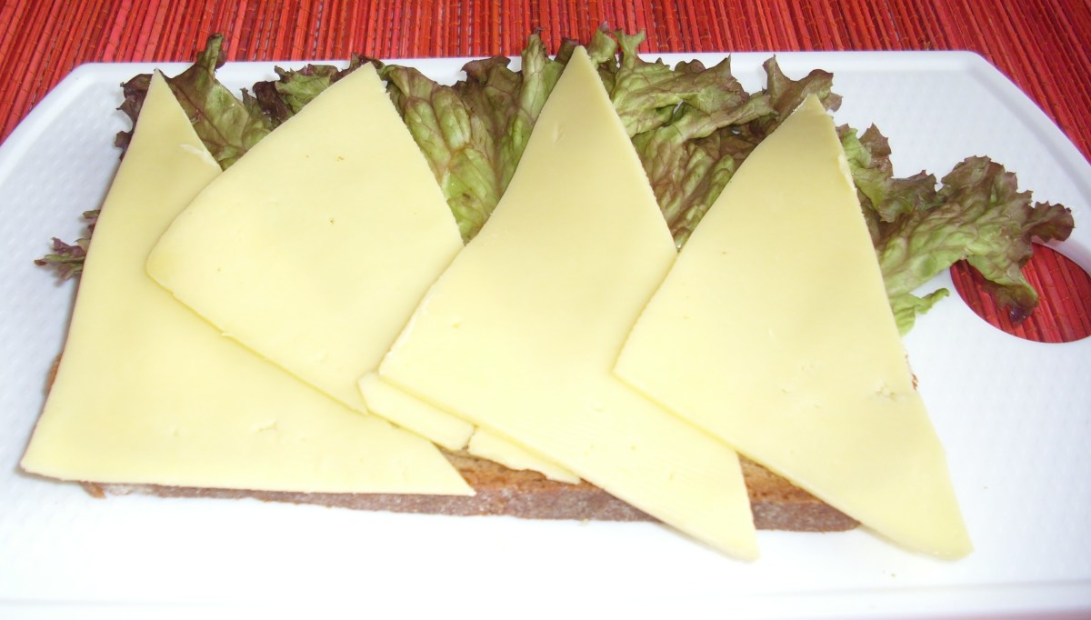 Sliced Graubrot with lettuce and Gouda cheese.