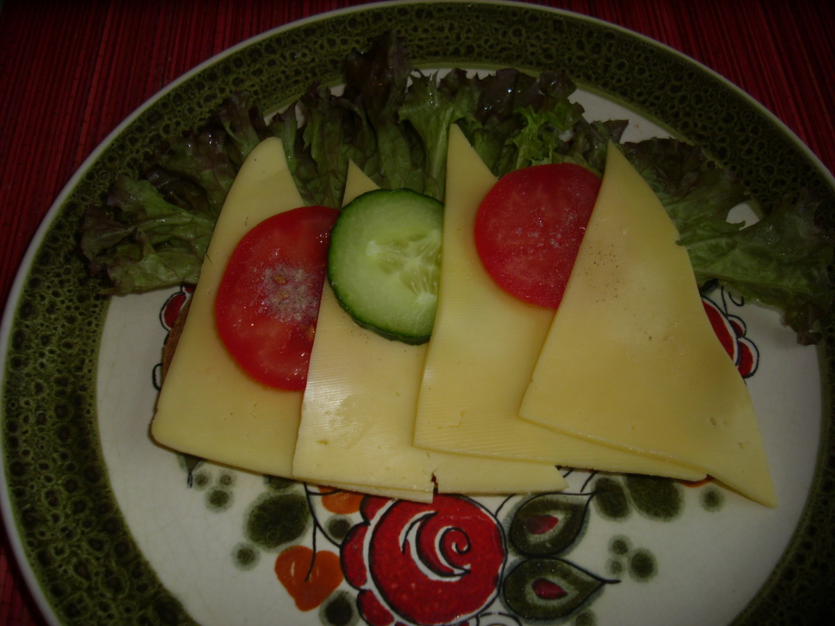 Insert slices of tomato and cucumber between the Gouda cheeses. Ready to eat Graubrot Gouda Cheese bread.