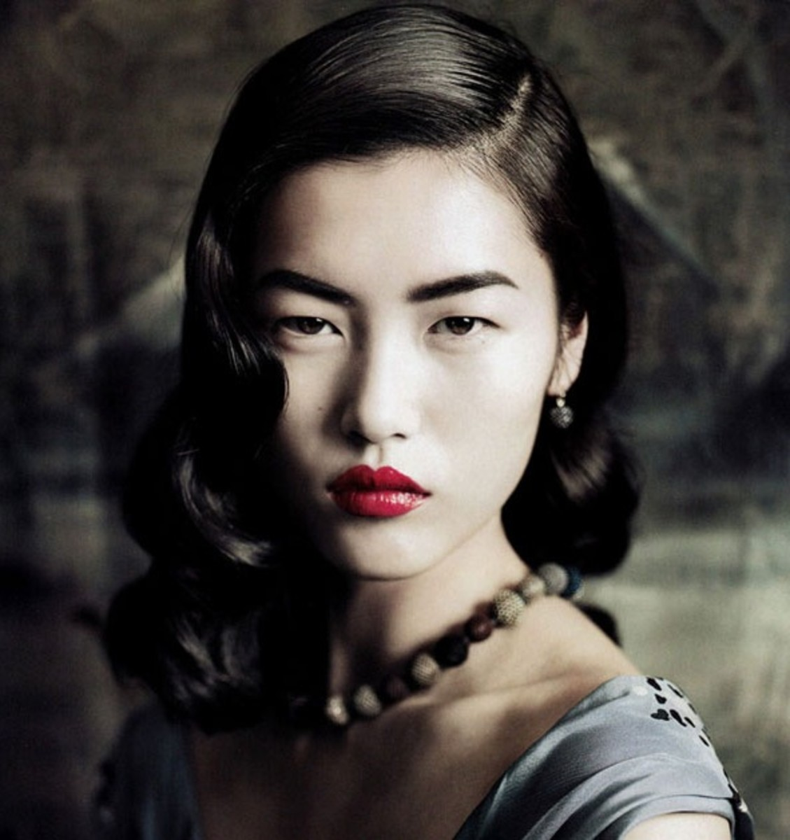 Deep red lipstick on Chinese model.