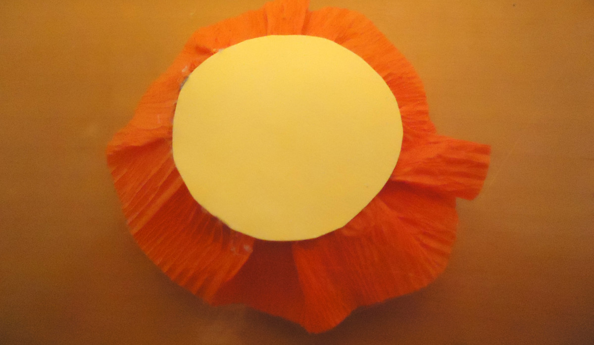 Circle glued onto crepe paper roll.