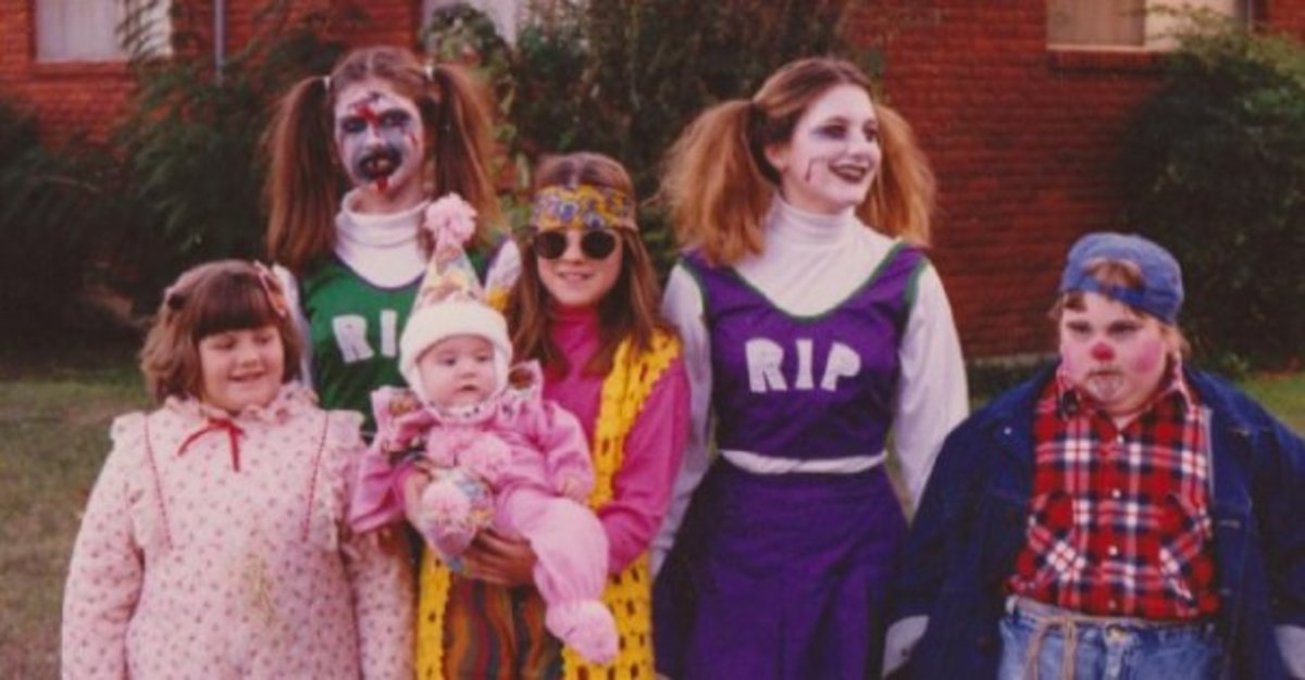 Ironically I found a family pic that almost had all the costumes mentioned. Zombie cheerleaders, hobo, clown, housewife and hippie