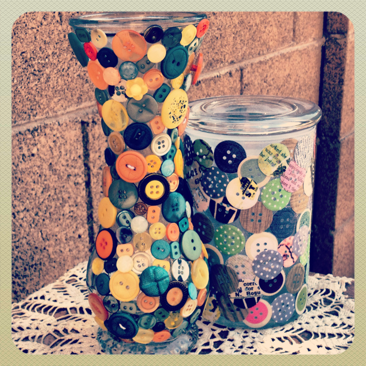 Vase and jar covered in buttons