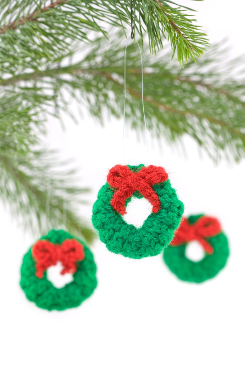 Crocheted Wreath Christmas Decorations by South12th  DESCRIPTION Crocheted Wreath Christmas Tree Decorations Hanging isolated on White