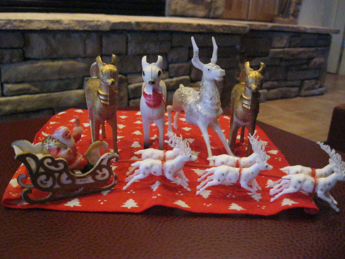 A variety of plastic reindeer, glitter, painted embellished