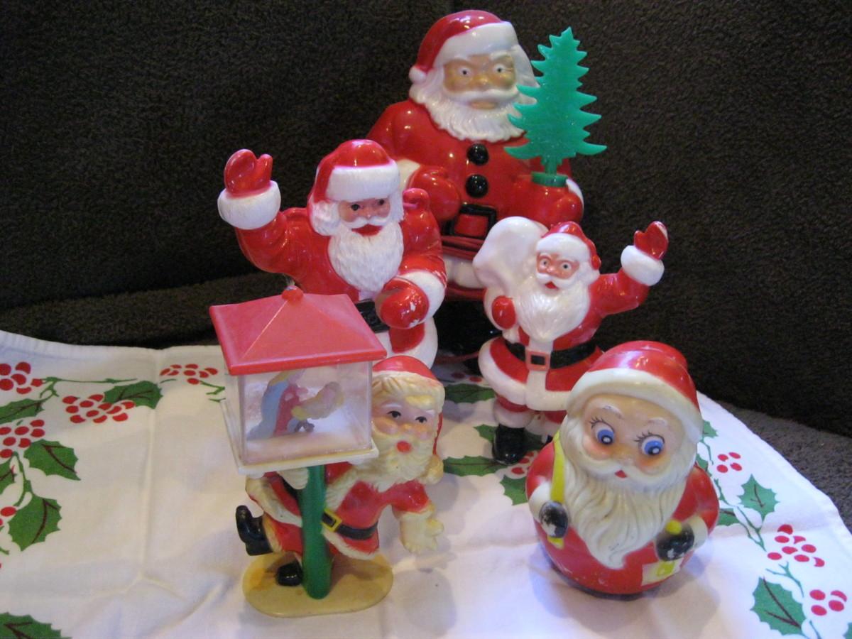 Waving Santas, Drunken Santa clinging to lamp post, and round bottom wobbling Santa