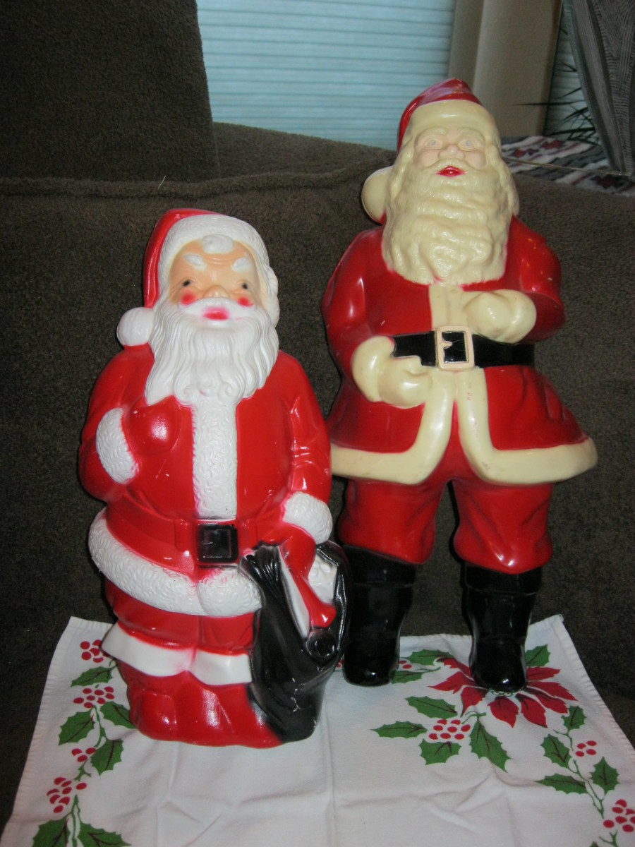 Two blow mold Santas, hollow inside and opening in back for Christmas light  Tallest is 16 inches, smaller is 12 inches high