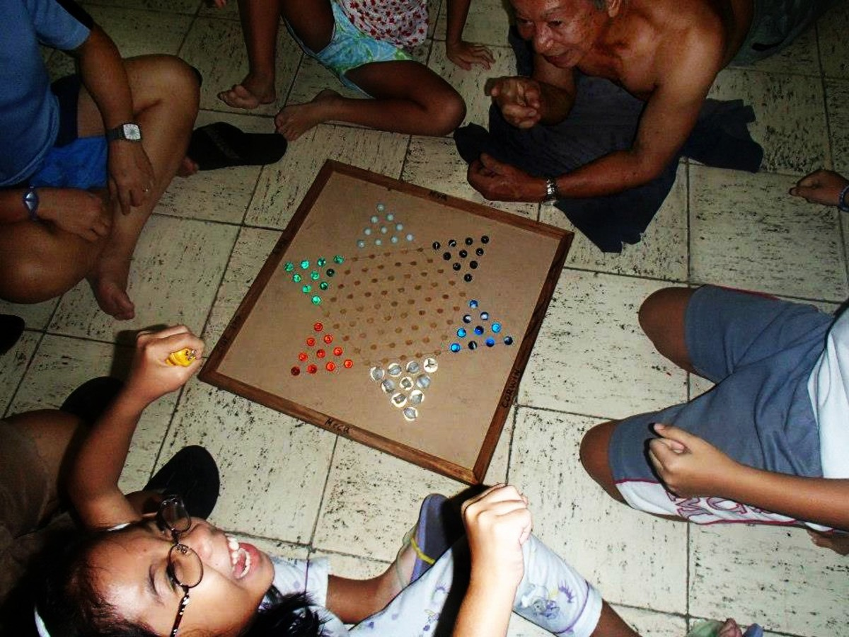 The Chinese Checkers game board my pa made for the family. My little niece must understood the game.  Photo Credit: Missy Mabugat-Torralba
