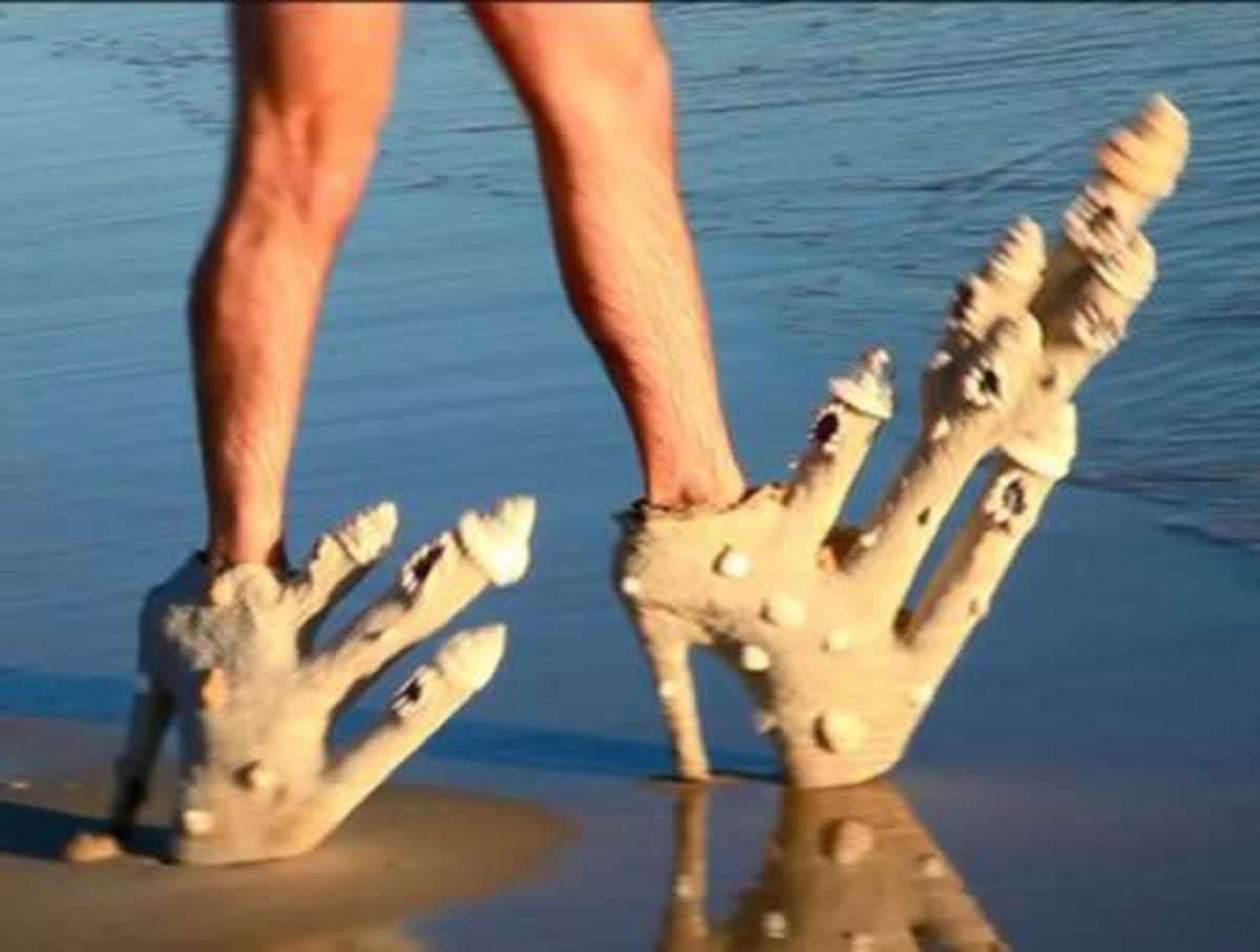 Sand castles and hairy legs. Just unusual beach attire