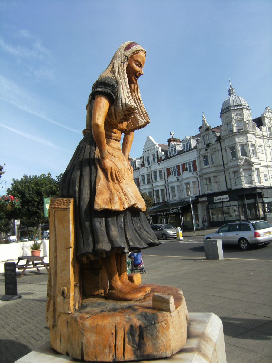 A Wooden Statue of Alice in Llandudno Wales