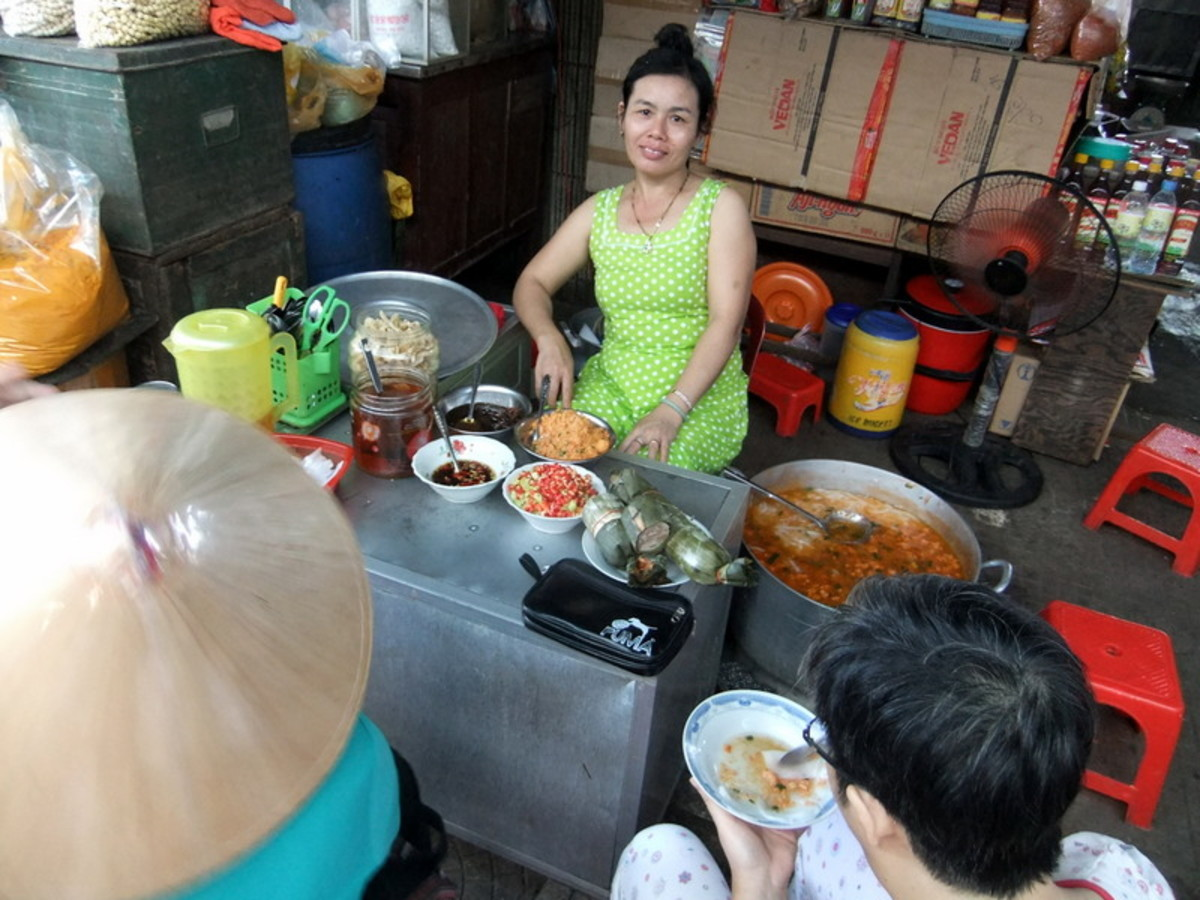 Street Photo in Hue, Vietnam: This woman sells Vietnamese porridge, at  Dong Ba market in Hue
