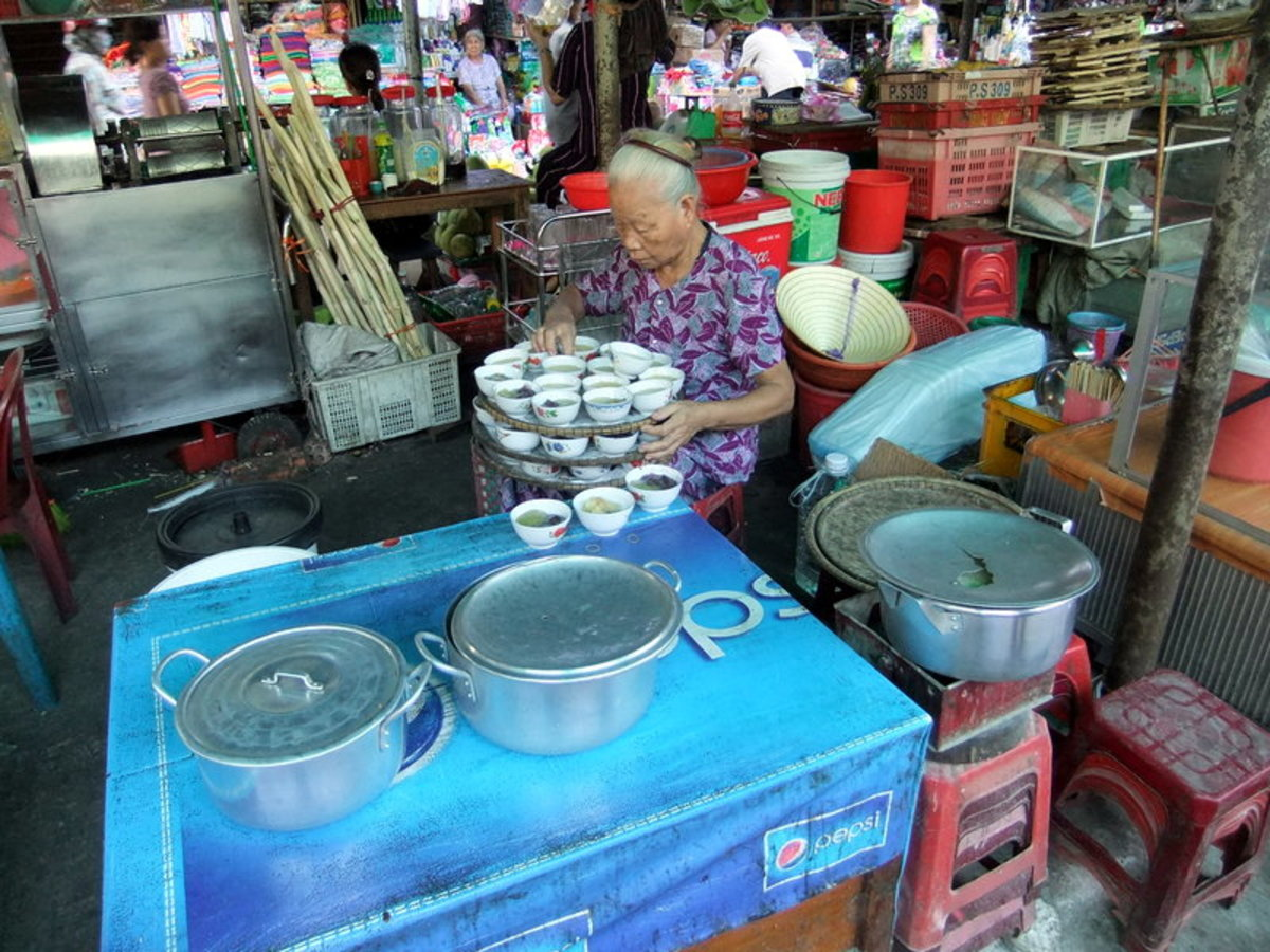 My travel to Vietnam: Preparing to get her stall ready for business at Dong Ba market in Hue