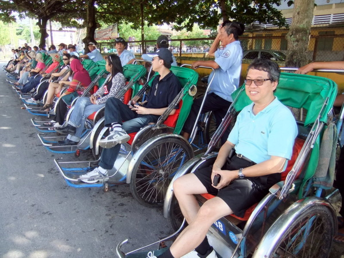 Street Photo in Hoi An, Vietnam: Our office had 65 cyclos to take us around Hoi An, giving business opportunities to these drivers