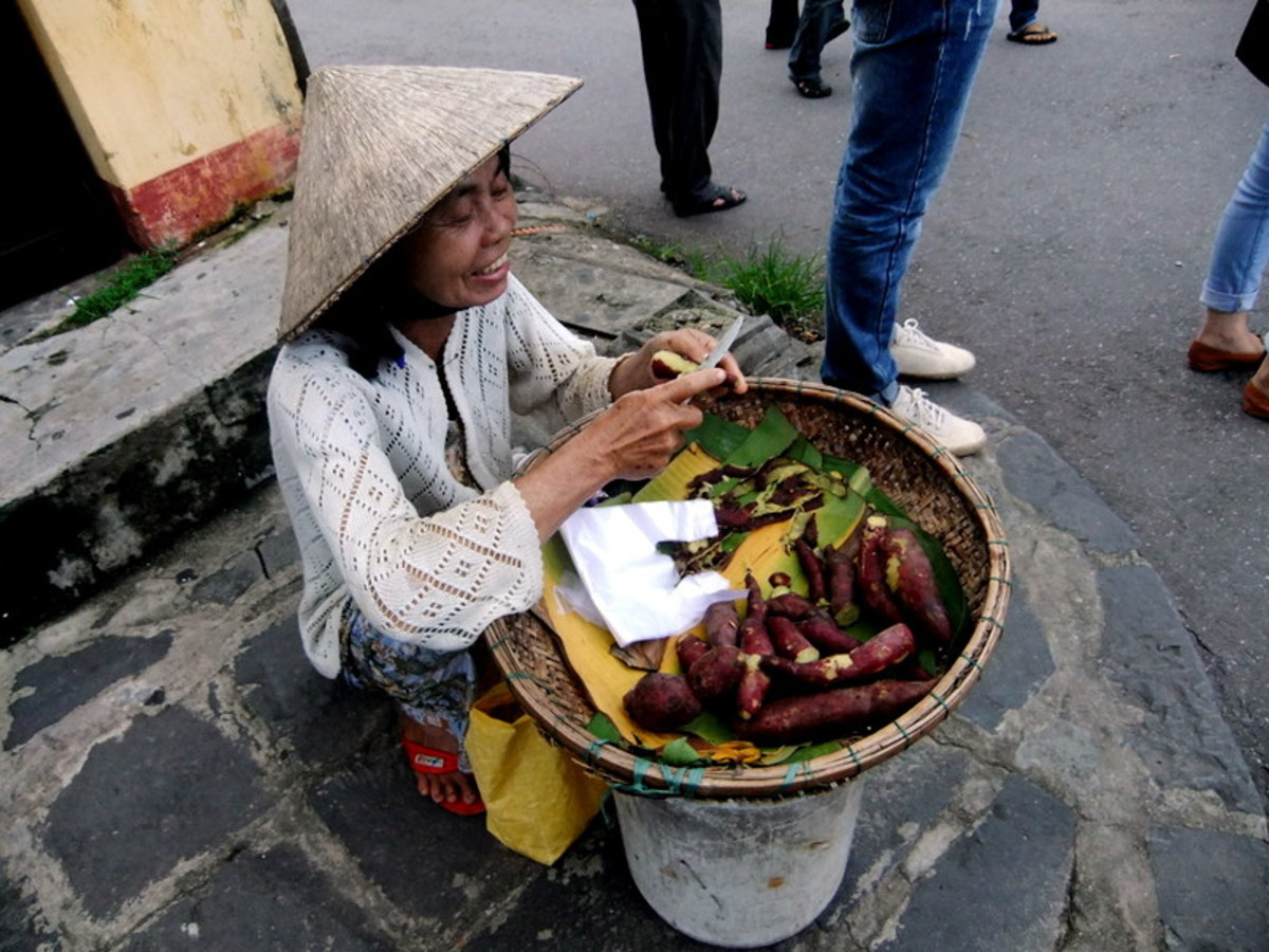 Street Photo in Vietnam: I bought my sweet potatoes from this extremely cheerful woman