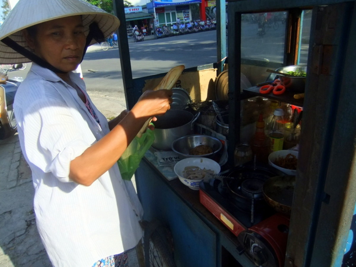 Street Photo in Hue, Vietnam: This food vendor was selling Vietnamese food for breakfast near our hotel in Hue