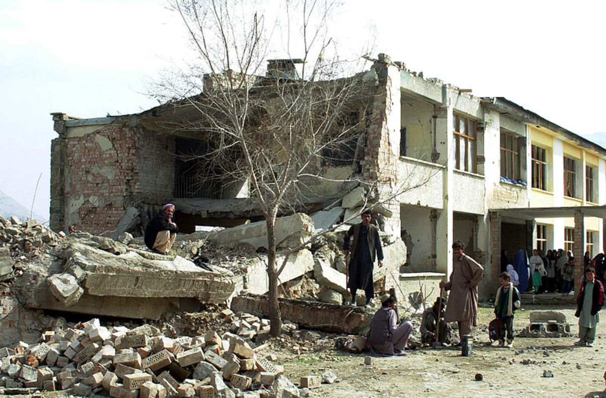 Children, including girls, queuing for school in Kabul - the school was nearly destroyed in war