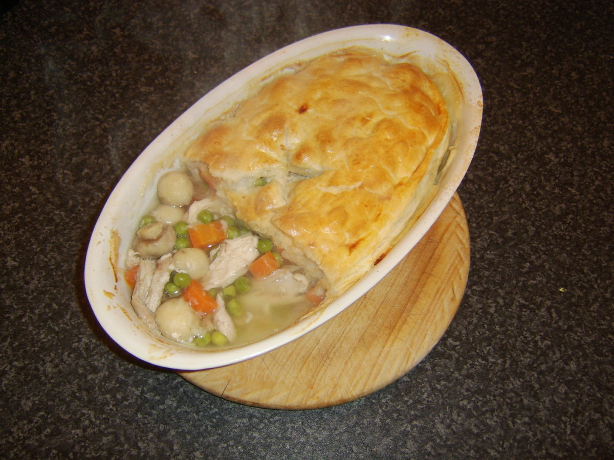 Portioning the chicken and mushroom pie