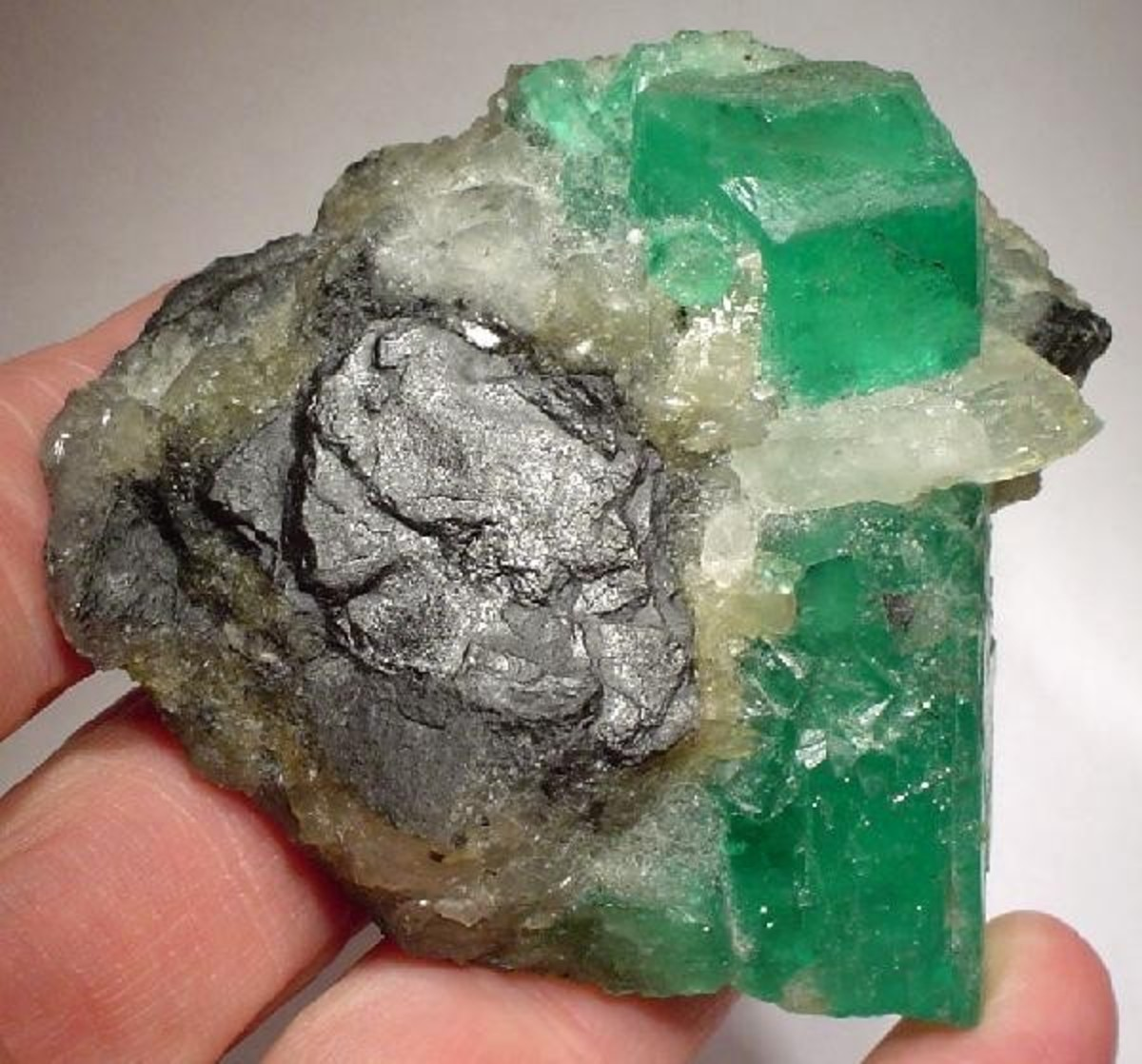 Emerald crystal in calcite and shale matrix from Colombia.