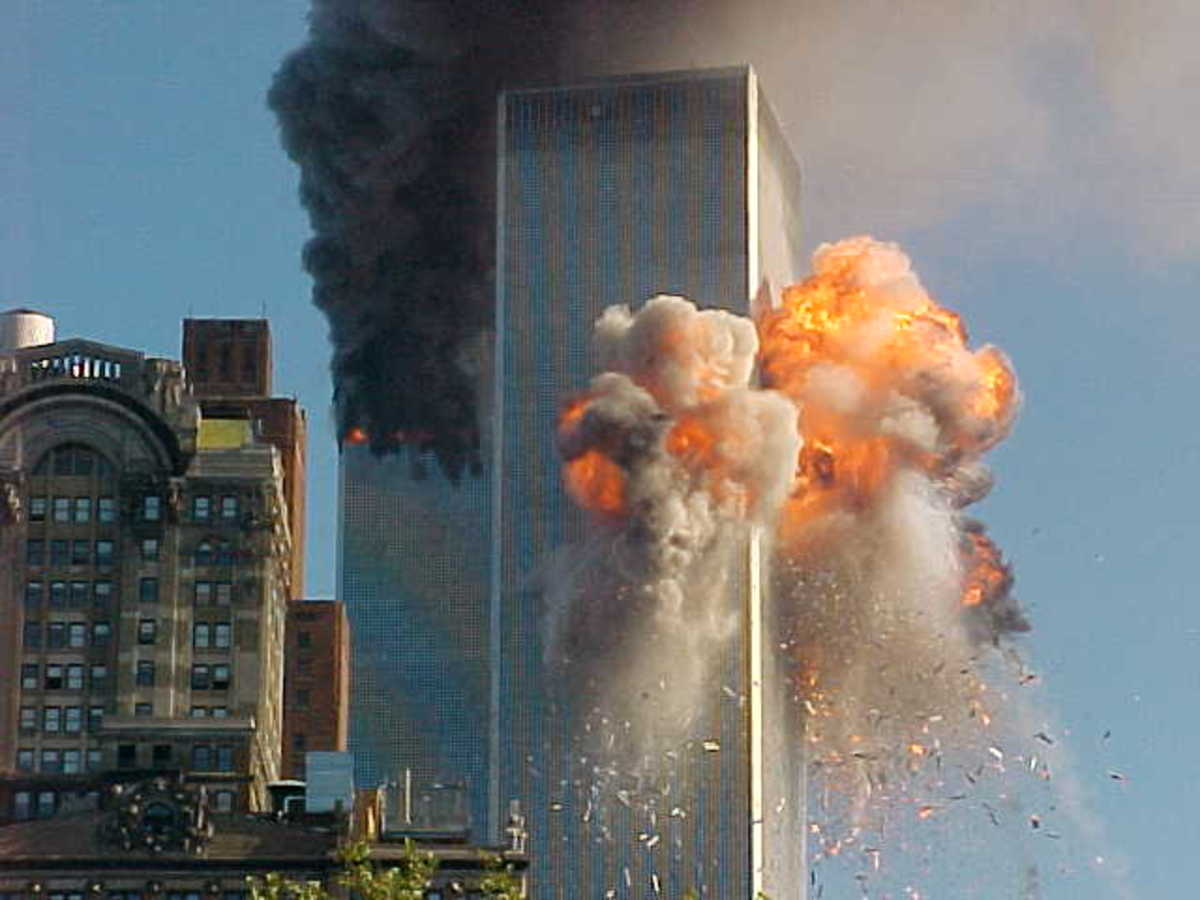 This photo is of the initial strike of WTC 2. WTC i has already been struck and is burning in the background. Later, both buildings collapsed in a cloud of dust and a swirl of controversy.