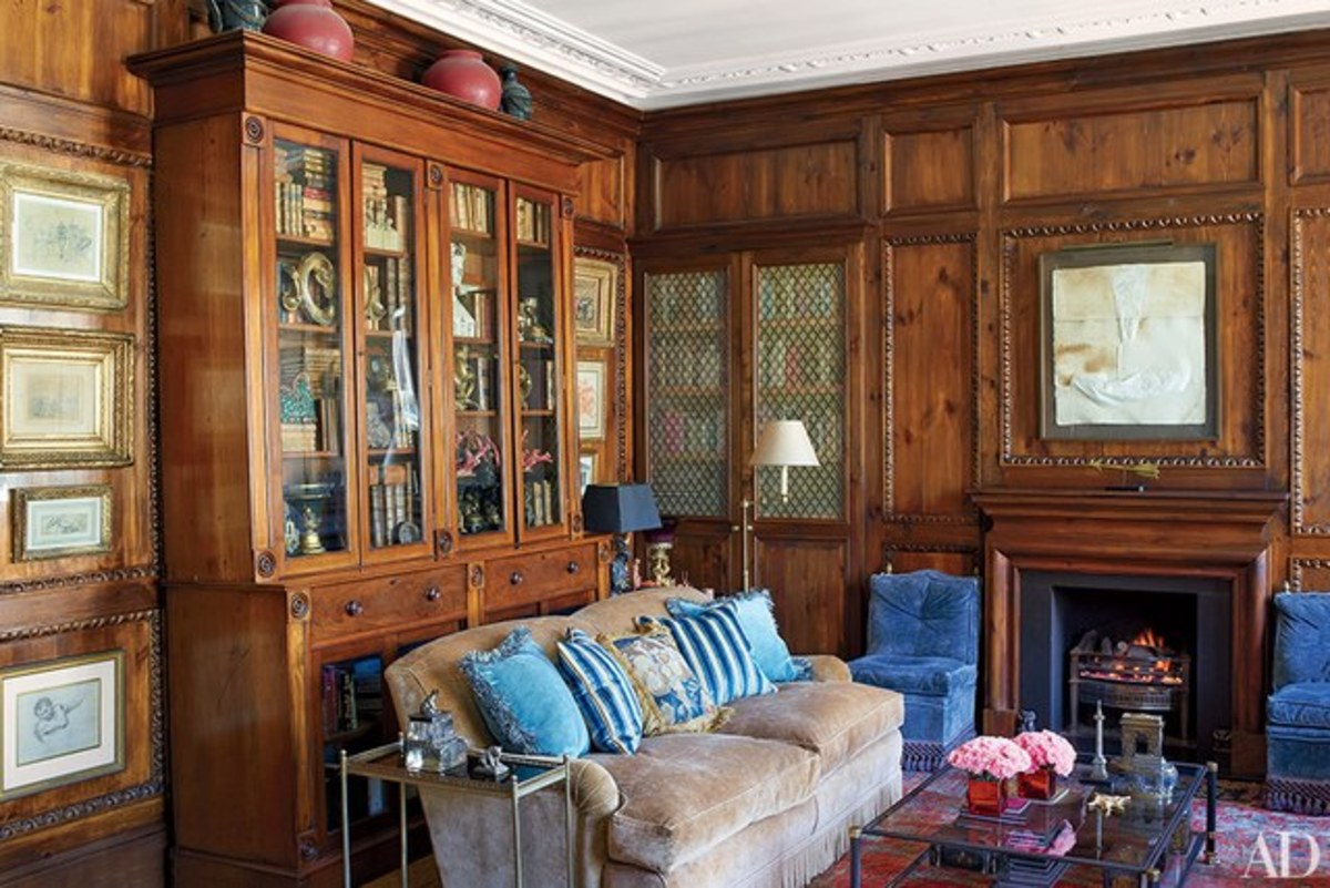 Rich wood paneling creates a warm sophisticated study.
