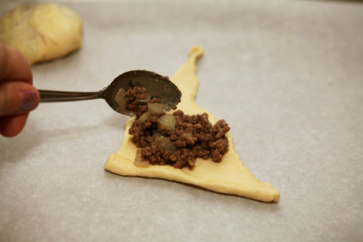 Spoon the meat mixture onto one triangle of dough.