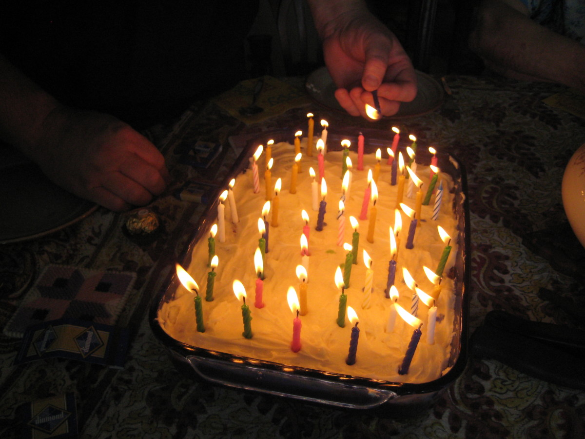 light candles starting from the inside and work to the outside to avoid stretching over the flames and risk getting burned.