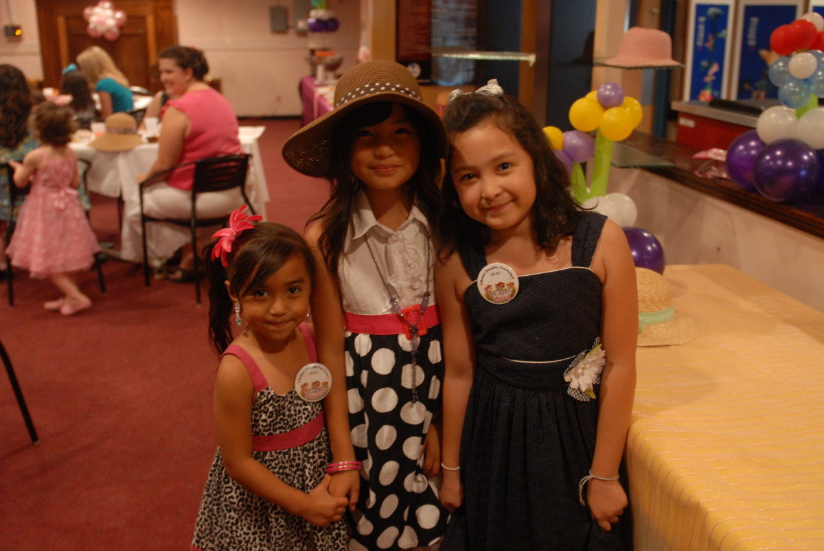 adding a little makeup will complete a look when dressing up like these little girls did for a mommy and me tea party.