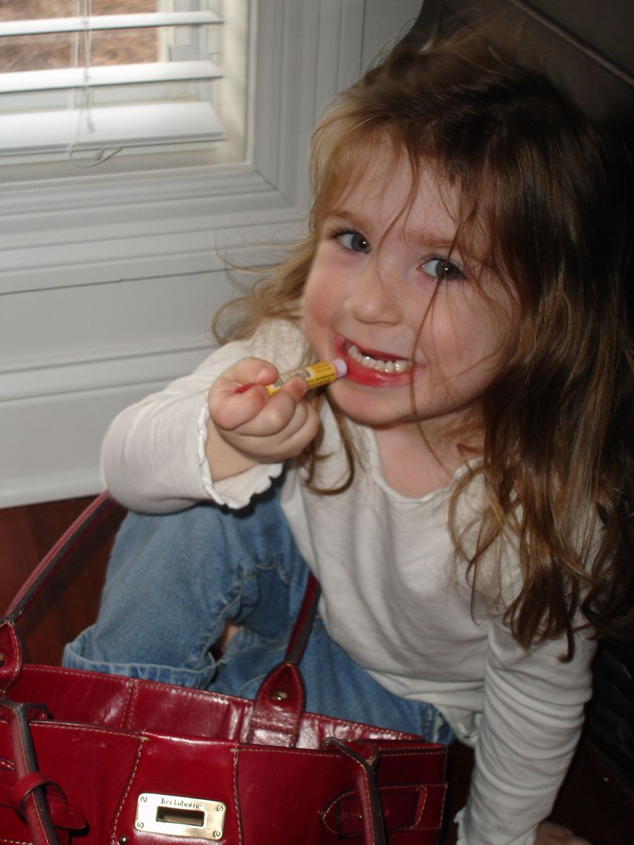 little girls love going through mommy's purse for her lip gloss and applying it herself.