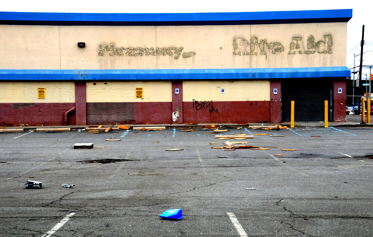 An abandoned store, with obvious signs of decay.  A bad neighborhood is one where businesses move out of.