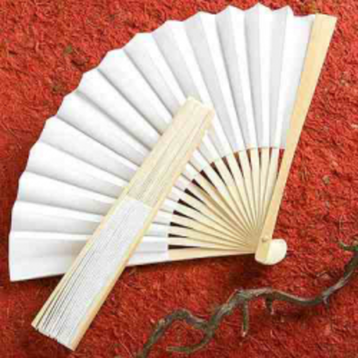 White color hand fan is quite perfect for making a wedding invitation.