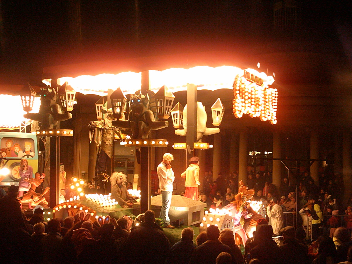 A Carnvial Club Float, lit by hundreds of bulbs, watched by thousands of people