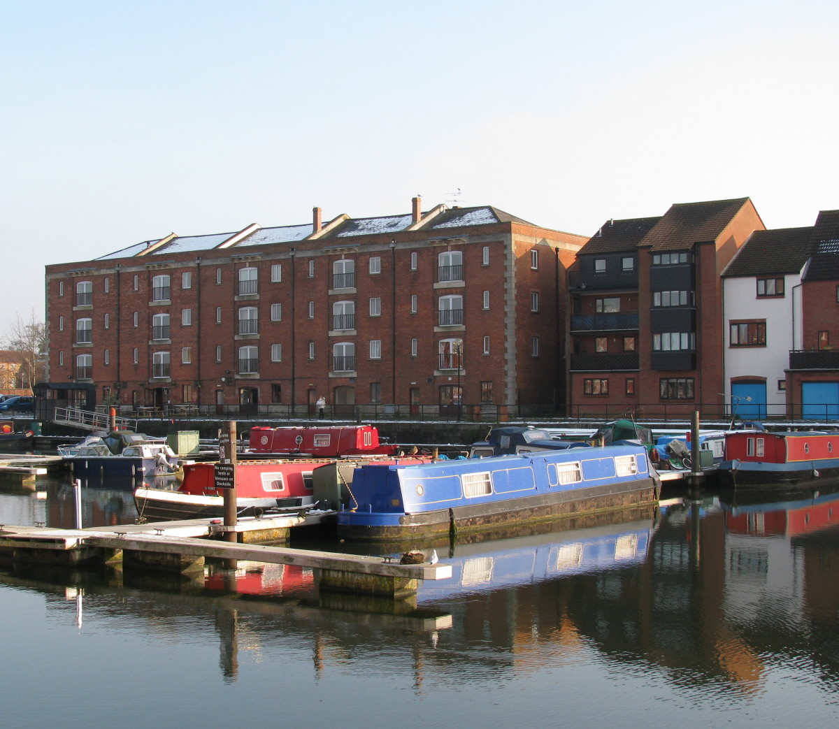 Narrow Boats with the converted Warehouses (now flats) in the background