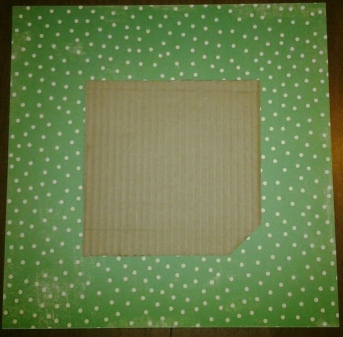 "1. Place the corrugated cardboard in the center of the ""wrong"" side of the cover paper."