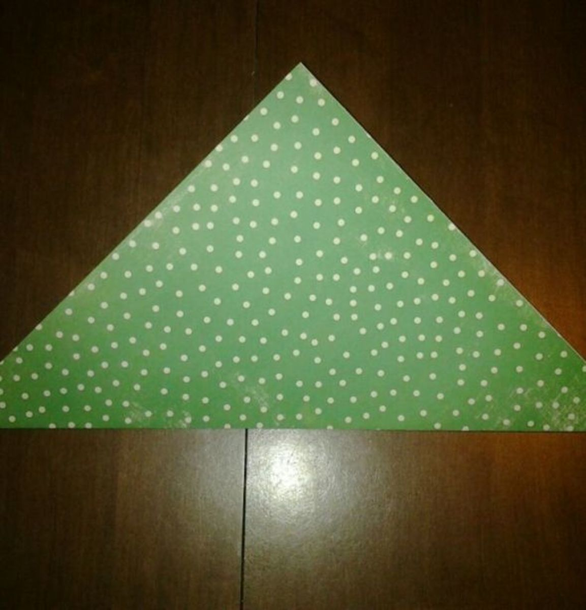 2. Fold the paper diagonally once (corner to corner).