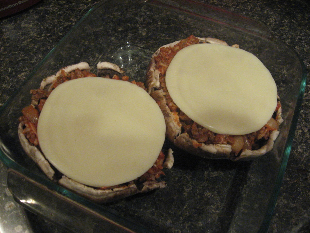 Place a slice of provolone on each filled cap.