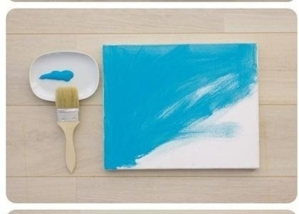 Step 2: Apply a different base coat of paint with the chip brush to each of  the stretched canvases, including the edges.