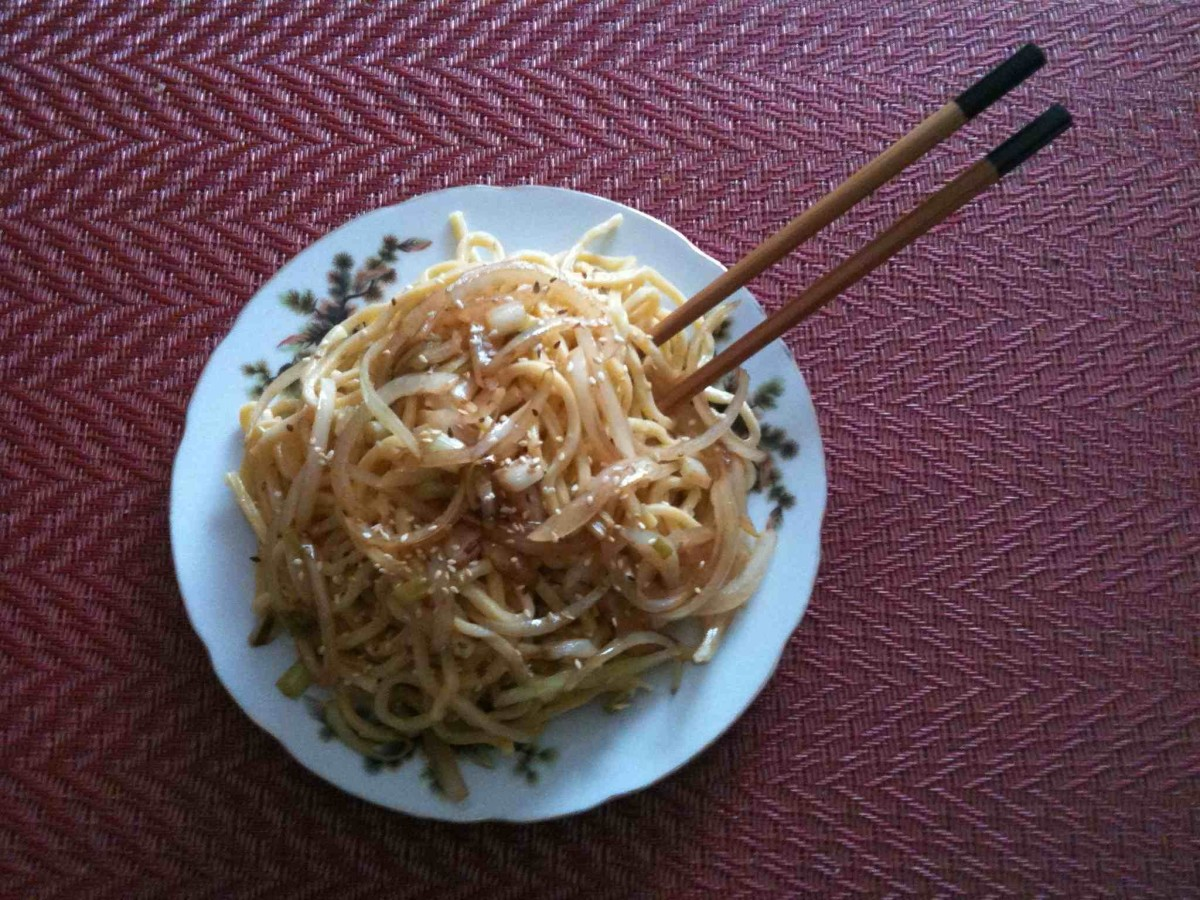 Lo mein noodles with onion, scallion, roasted sesame seeds, sesame oil