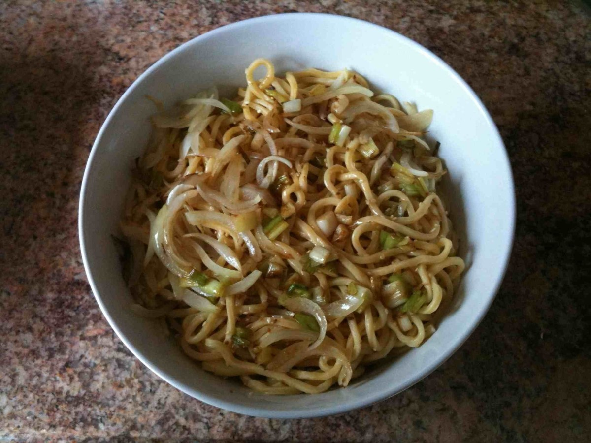 lo mein noodles with onion, scallion, roasted sesame seeds and sesame oil