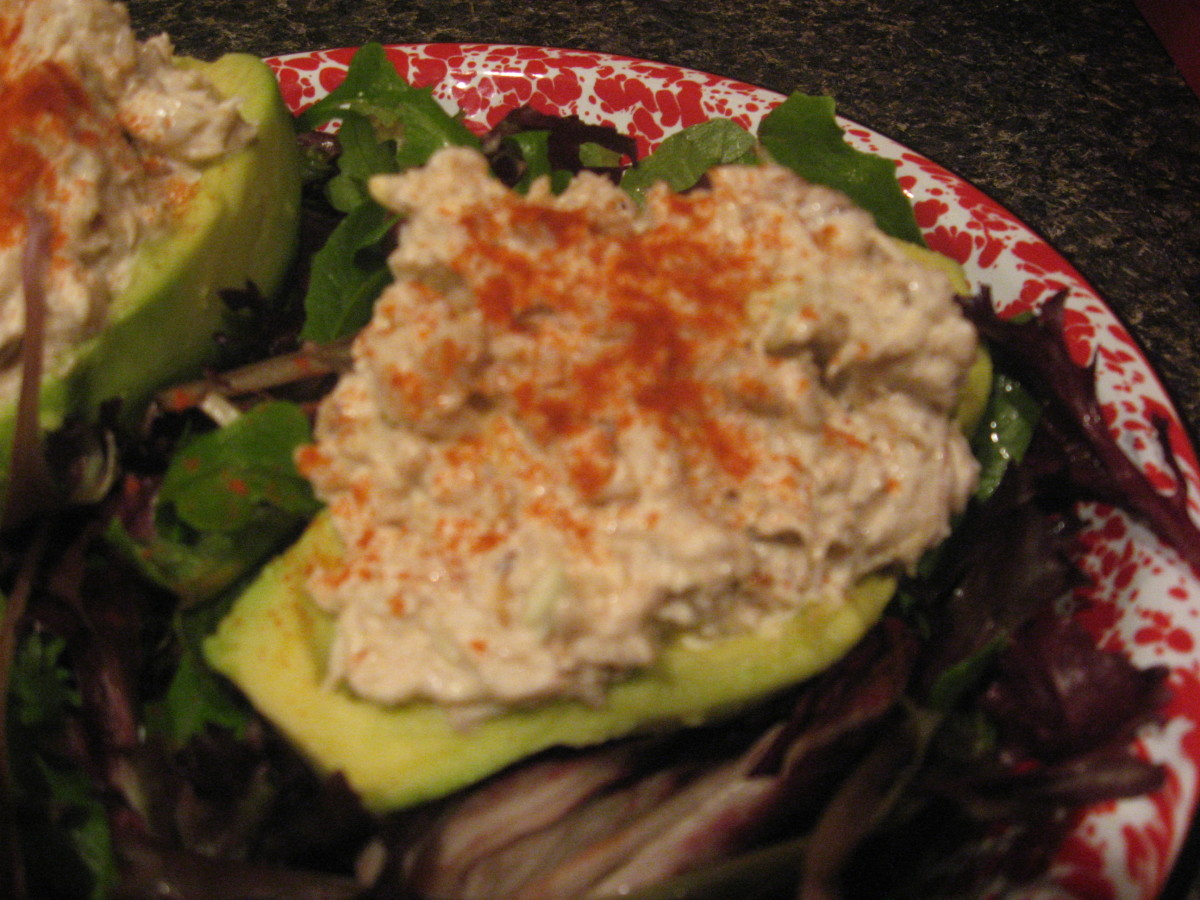 Fill the avocado halves with crab salad and serve on mixed greens.