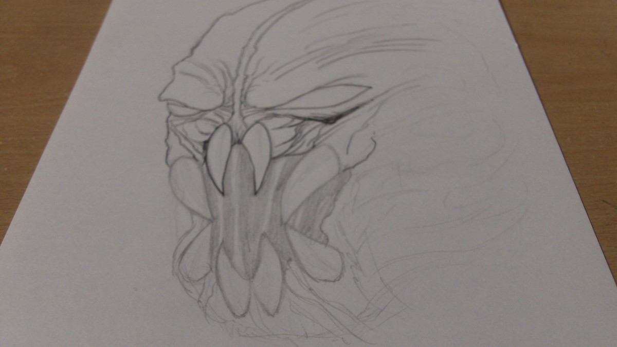 A Demon head design based on the Predator creature. I started to ink the mask pencil sketch.