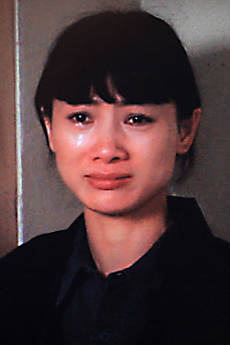One of the most poignant moments of the movie as a tearful Shen Yuelin reveals her innermost secrets to Jack Moore
