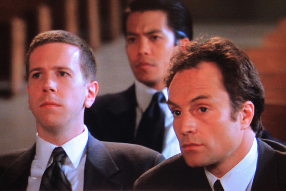 Robert Stanton plays the consular official and Bradley Whitford plays Jack's associate. Byron Mann as Lin Dan is seated in the background