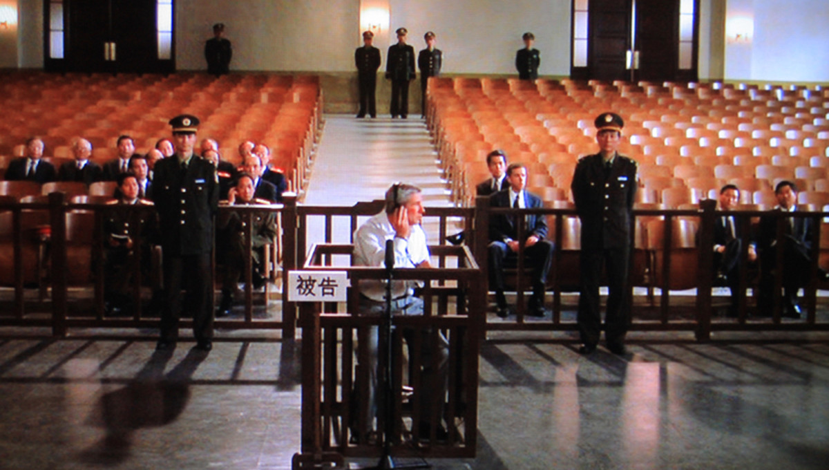 The expansive yet spartan and unfriendly courtroom with Jack Moore centre stage