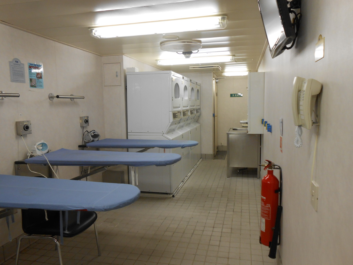 Laundry room for passengers with washers, dryers and ironing boards.