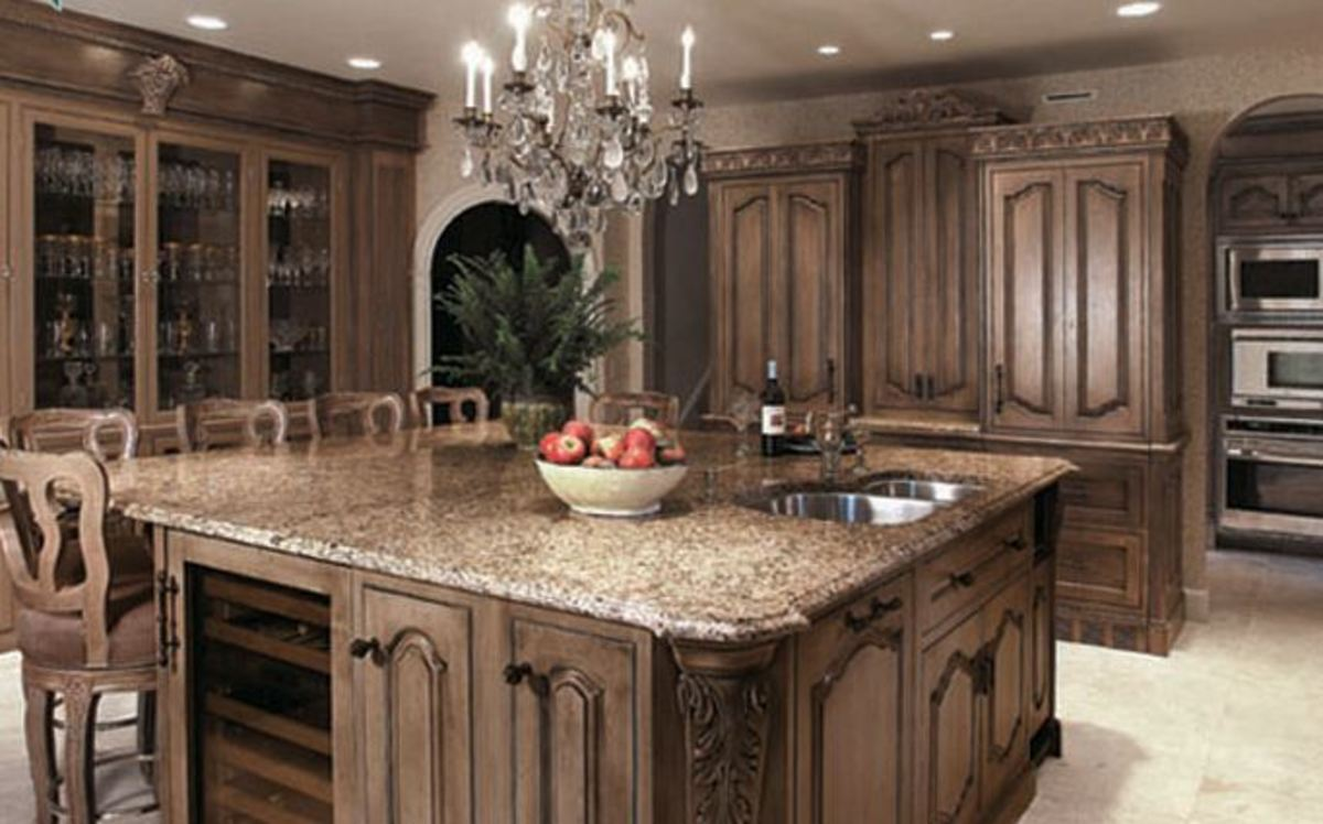 furniture quality cabinets in brown glaze with a single chandelier make craft this estate quality kitchen