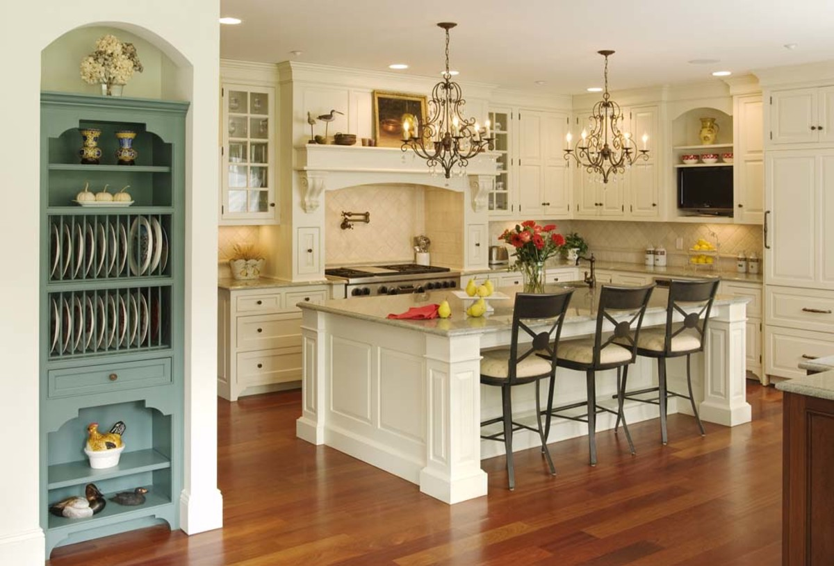 Victorian style designed kitchen with double chandeliers, wood flooring