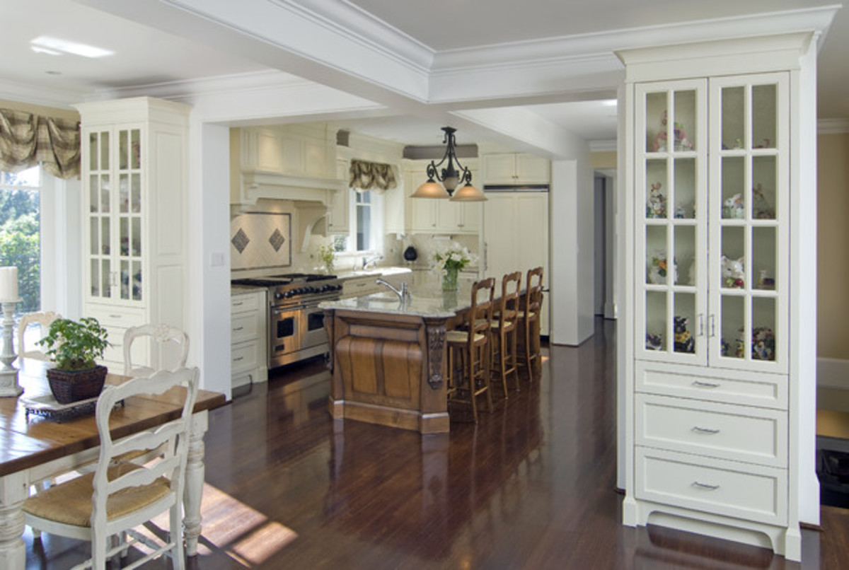 wood flooring in the kitchen combined glass cabinets creates an Old World kitchen design
