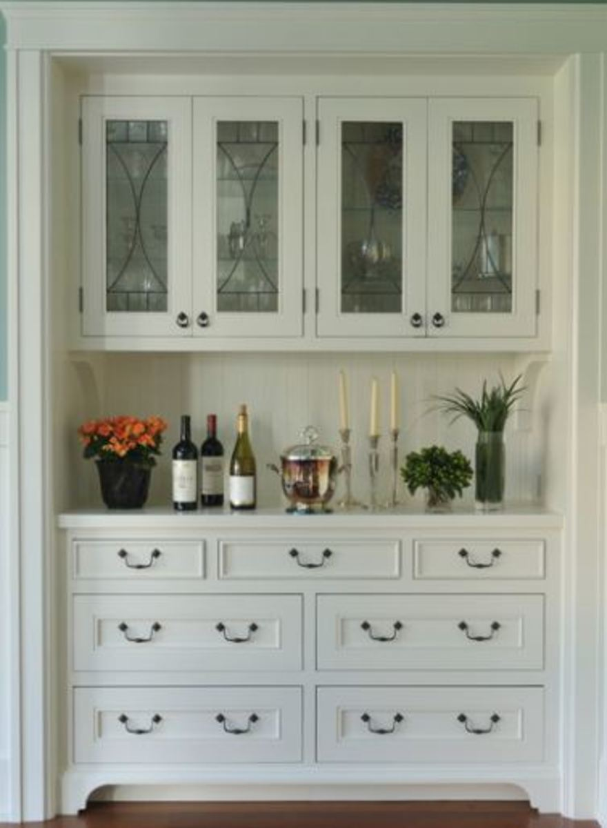 built in cabinets with furniture quality knobs and pulls set this bank of cabinets ready for your butler or for you personal use.